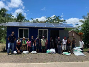 IP community with the sacks of fertilizer donated by TESDA, with the AGAK center in the background. The Ata Manobo tribe of Igang is led by Datu Manuel Mampaundag.